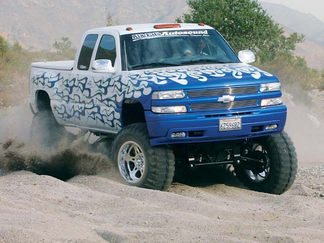 0311or 20z+2002 Chevrolet Silverado Quadrasteer+Front Passenger Side View In Motion Kicking Up Dust