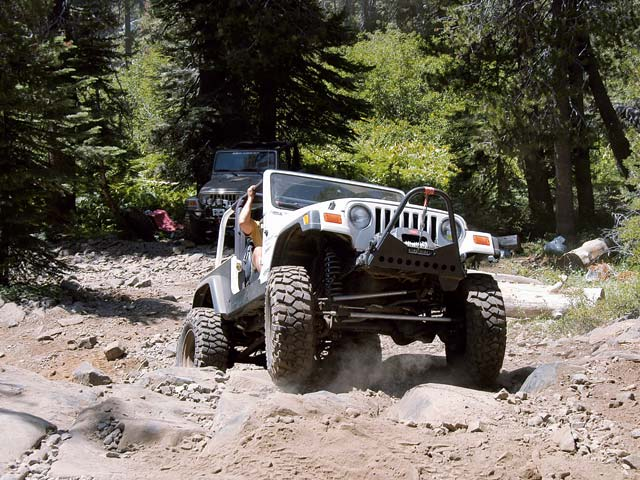 06014wd 12z+Jeep+Front Passenger Side View Car Over Rocks