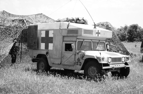 The military uses several different bodies on the Hummer, including an ambulance, a light-duty cargo carrier, a light-duty passenger carrier, and a heavy-duty cargo carrier. Civilian models are also available in a variety of styles, including a two- or four-door hardtop, a two- or four-door soft top, and a four-door wagon. Both military and civilian Hummers have a 1-1/4-ton rating, and all military models come standard with a pintle hitch. There&#8217s a spot tucked under the vehicle ahead of the hitch for a shovel and an ax that&#8217s not found on civilian models.