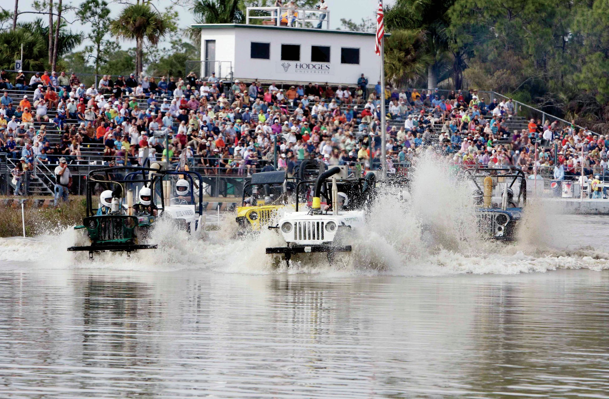 Here, a group of Jeep-class buggies navigate the course at the beginning of a race. This class uses a land-rush start from the start line. Speedy? Sorta. Fun to watch? You bet. Visuals include lots of flying water and the soundtrack of the Jeep four-cylinder engines.
