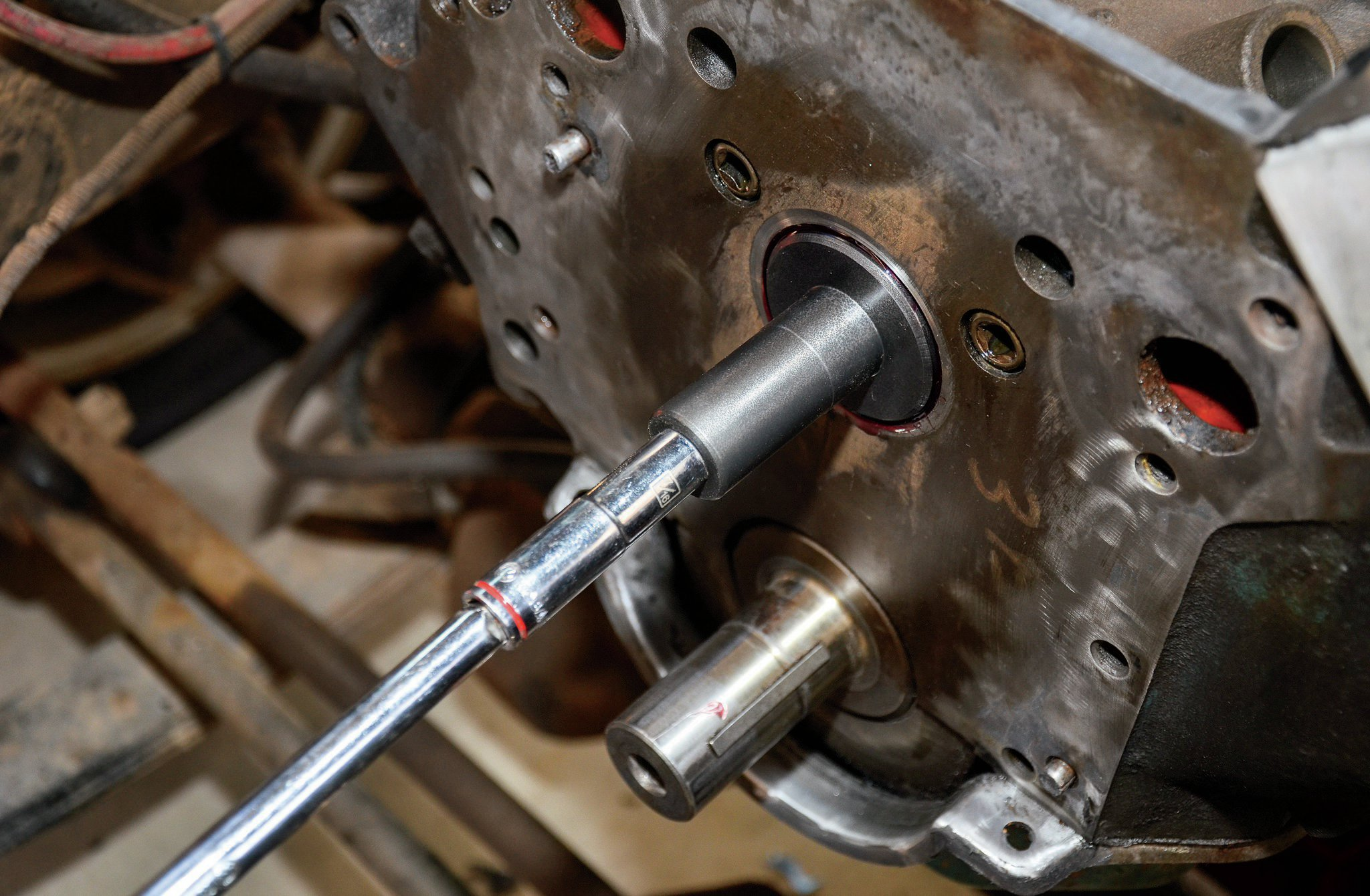 """Once we got the cam almost all the way installed, our friend, Doug (who is a full-time mechanic that tolerates our foolishness), said we could make an impromptu cam installation tool with a long stud or bold, a socket that fit over the stud (or bolt), and an extension. This """"tool"""" helps you get the leverage on the cam to get it that last few inches into the cam bearings."""