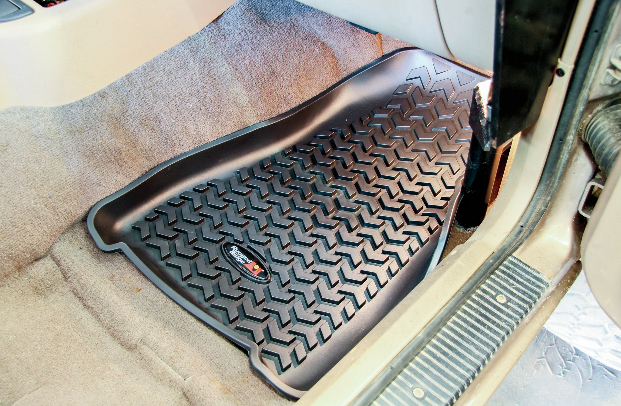 Before we could bolt-in our seats, we needed to get the carpet put back in place. Since this Jeep is based in the Southeast where mud is part of the wheeling experience, we went ahead and dropped some floor liners in from Rugged Ridge. Having a liner that you can easily spray off is well worth the modest investment.