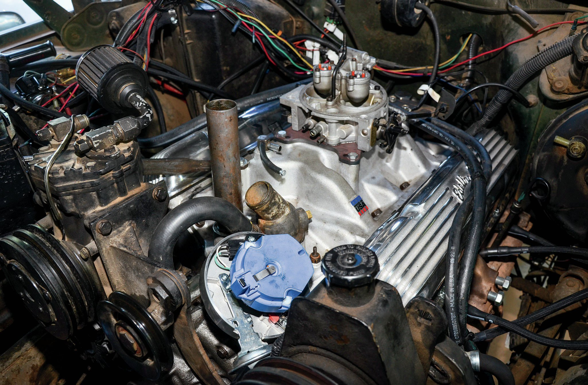 So, not all that happened with the first cam was bad. Sure, we wish it would have worked out fine without all this work, but by god, we now know just how to stab the Davis Unified Ignition distributor in this engine. Also remember to use a manifold vacuum (rather than ported vacuum) source for the distributor's vacuum advance, and don't forget to disconnect and cap this manifold vacuum when setting the initial timing. Edelbrock recommends 10-14 degrees advanced timing with the cam. That's a touch higher than our Howell TBI system recommends, but we will play with it as we put miles on the Jeep.