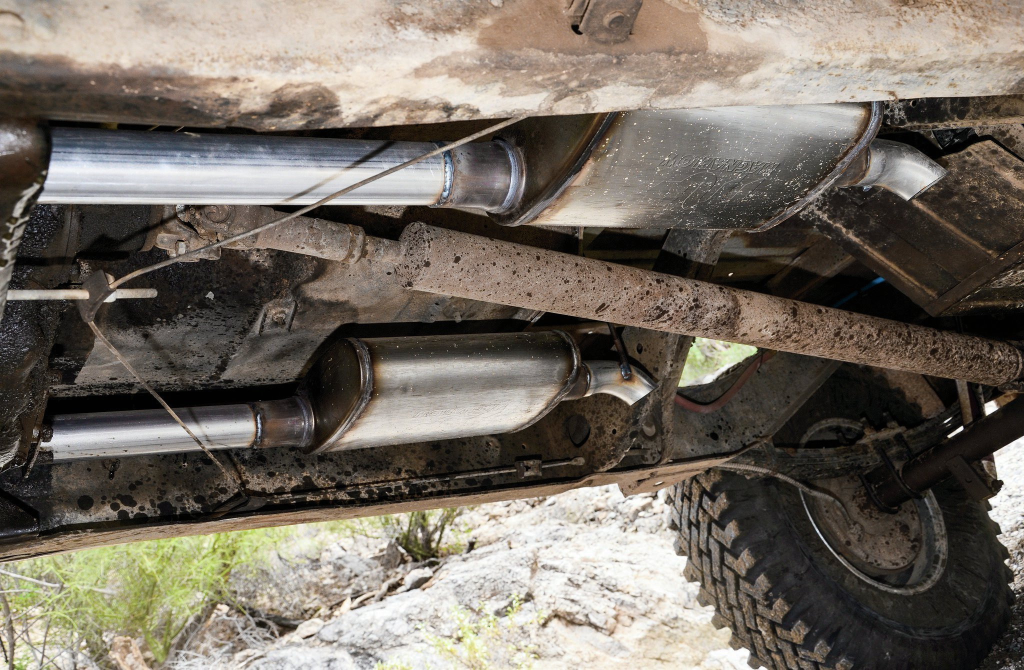 So, we know we are going to catch flack from all the hot-rod Jeep folks about running exhaust manifolds on a performance build, but hey, we also went with a milder cam 'cause this thing is a truck with a truck transmission in it. The fact is, we just don't want to deal with headers on this truck, but we have always wanted to run dual exhaust, so that's just what we did. To save ourselves some time and headache, we took the pig truck down to Big Jim's Custom Exhaust. Once there, Ted hooked us up with a sexy system that isn't too loud or too quiet—just what we wanted. Next time, we'll toss the Pig back on AIRAID's dyno and see what she can do.