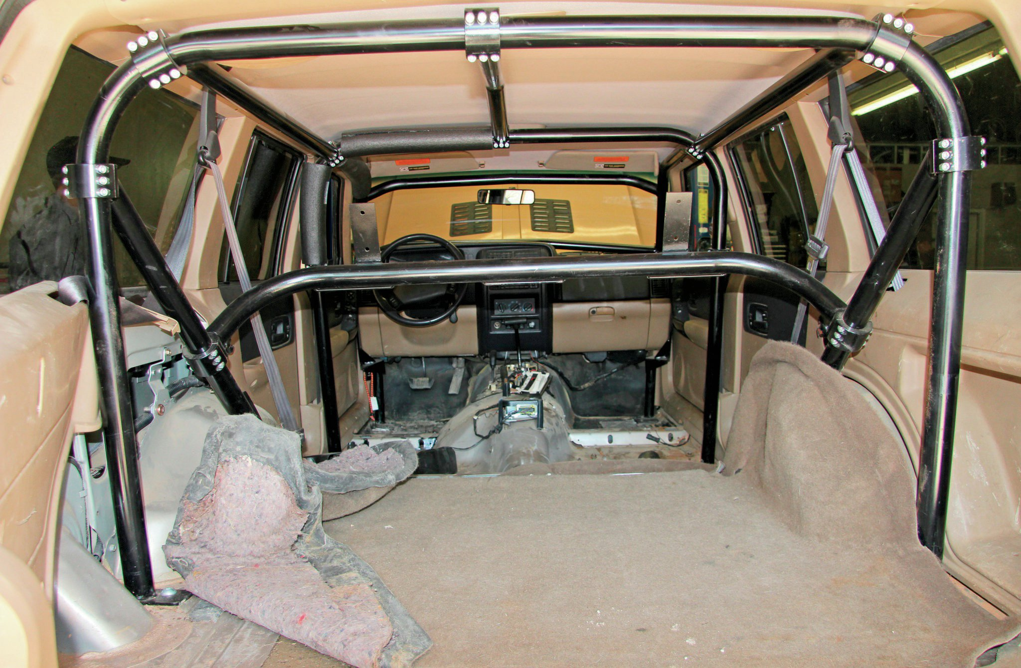 We got to the shop just in time to stop the remainder of the interior gutting. We were able to land the Rock Hard 4x4 interior 'cage in the deal but were on our own for some of the other interior pieces.