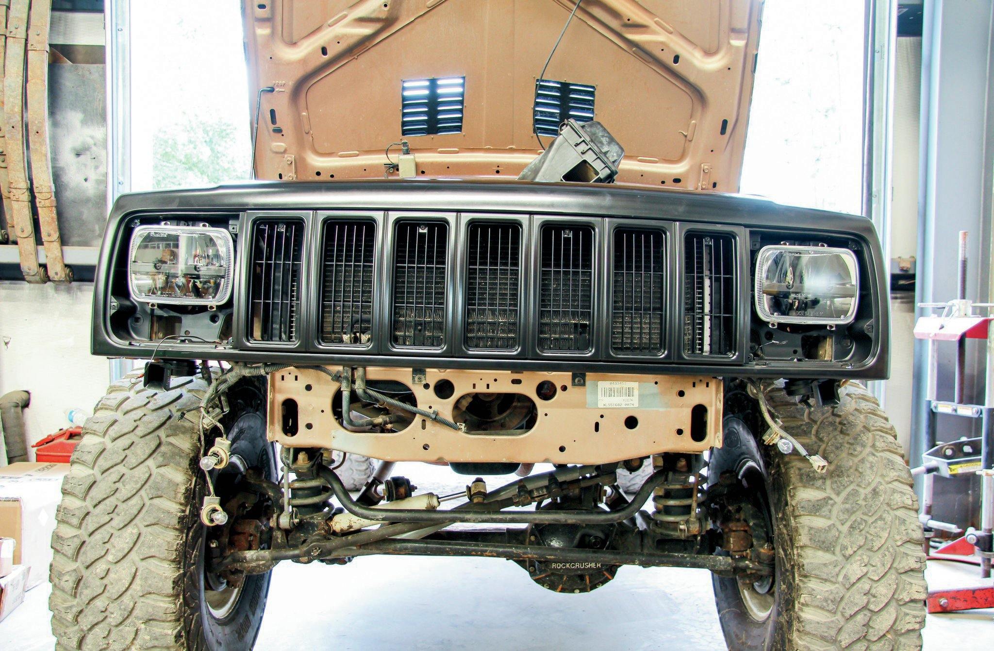 A convenient aspect about the XJ grill support is that the entire assembly can be taken off in one piece.