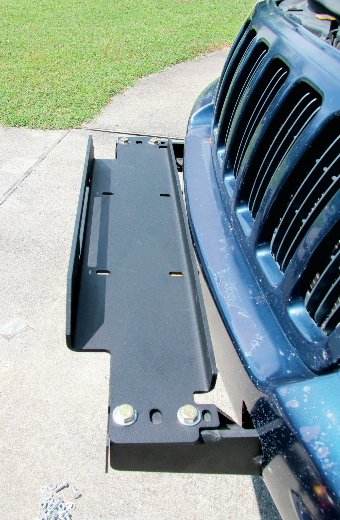 The winch tray simply bolts to the bumper arms. Be sure to attach your fairlead before setting the winch in place.
