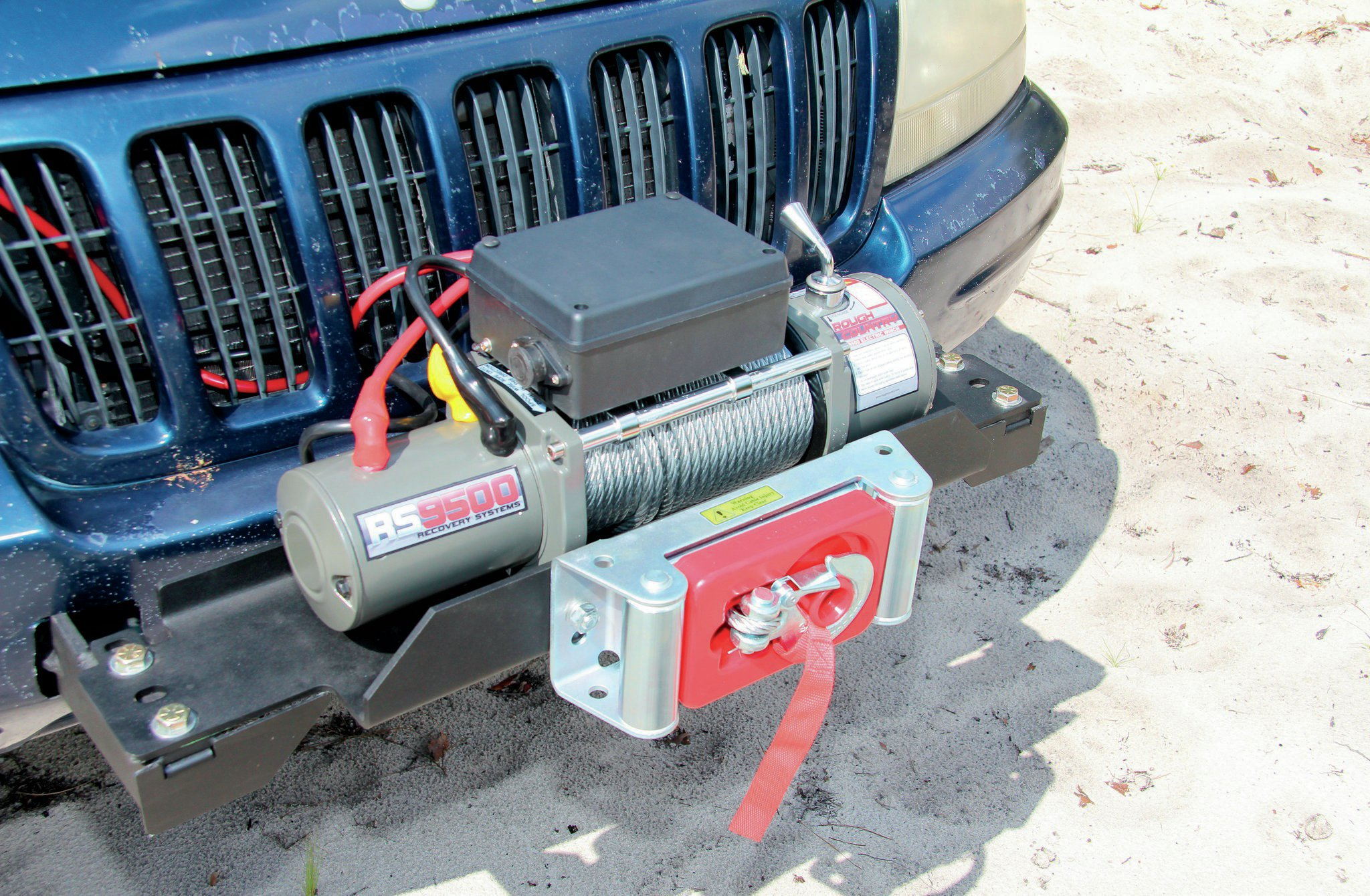 Our budget-friendly recovery tool of choice was a Rough Country 9,500-pound winch. We've used the RC9500 in the past with solid results. The only complaint we've ever had is that the winch is a little slower than we would like, but it always gets the job done. We went with steel cable for sheer strength, durability, and the fact that it was a little less expensive.