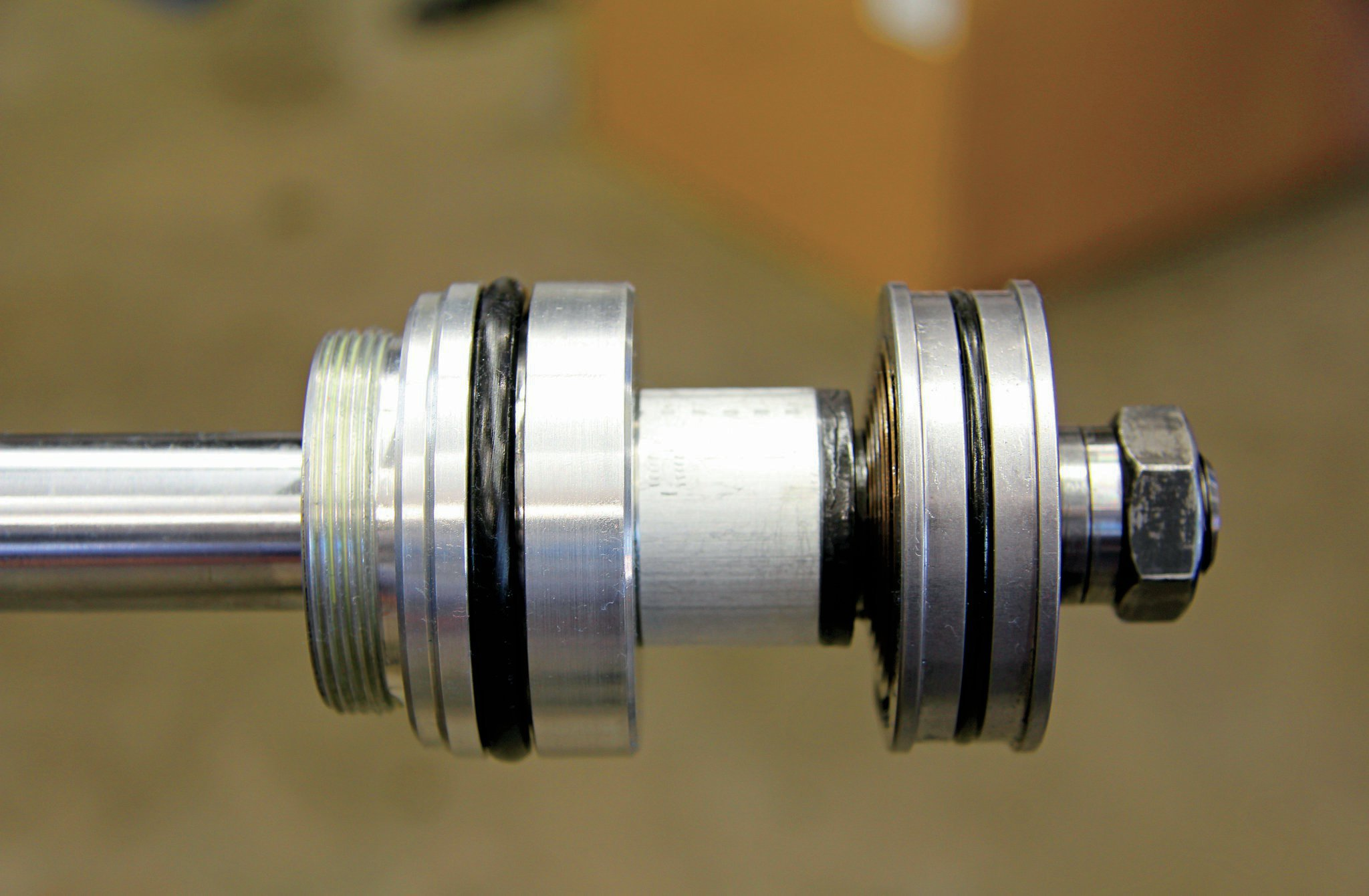 The 2.5 King coilover shock houses the valve piston you see here and a floating piston that resides in the fluid reservoir. To keep debris from entering the shock, King equips the shock with a dust cap, wiper seal, and Teflon-coated brass wear band, which extends the life of the shock, as well as deters leaks.