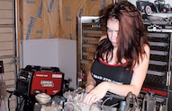 katie wrenching on engine
