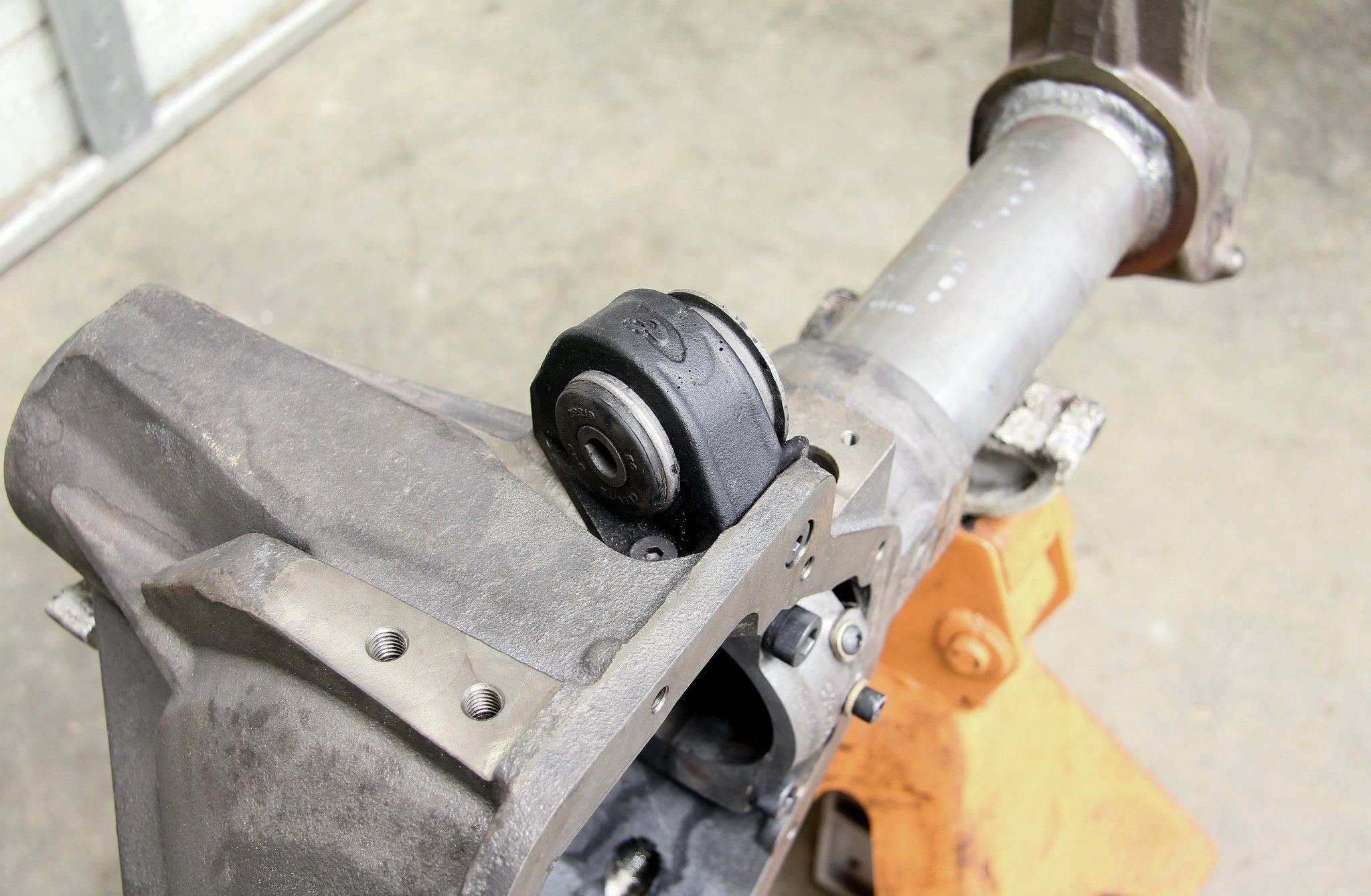 The one bracket that did come with the G2 housing was the upper control arm bushing. This setup actually bolts to the high-pinion American-made housing.