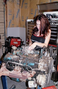 katie wrenching on jeep engine