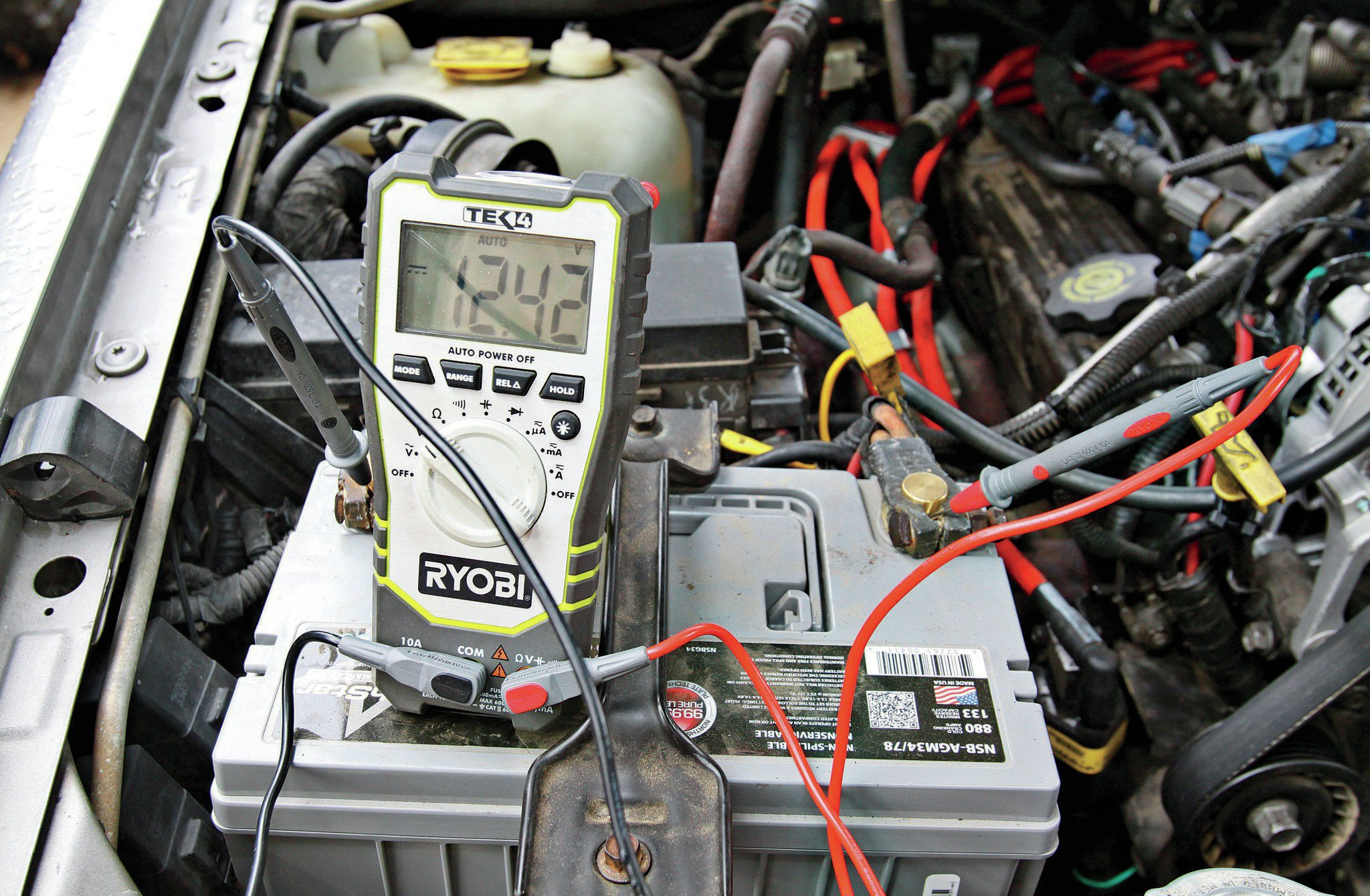 So, when the information center told him check battery, he took his multimeter out of his back pocket and checked it on the side of the road. The voltage read 11.7 V with the engine running. It should read in the mid 14s ideally with the engine on and in the mid 12s with the engine off. Something was wrong in here. It turned out that the alternator was dead. Grand Cherokees are notorious for killing alternators, but this time it was Trasborg's fault, not the Jeep's.