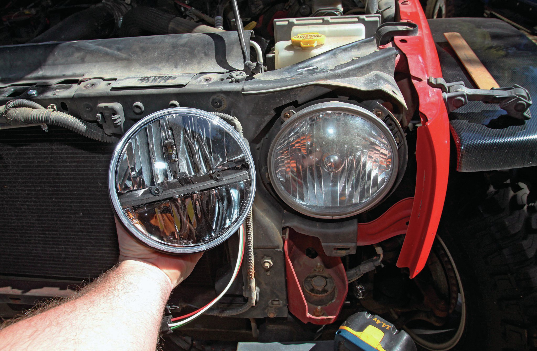 When the JK came out, I really loved the headlights. By 2014, this '07's headlights were sun-faded, with micro-cracks that no amount of buffing would clear up. I ended up driving around on high beams nearly all the time. I replaced the stockers with Truck-Lite's 7-inch round LEDs (PN 27270C). They might be the best round headlights I've ever had in a Jeep. The pattern cutoff on low beam is amazingly flat and the angle of coverage is actually over 180 degrees.