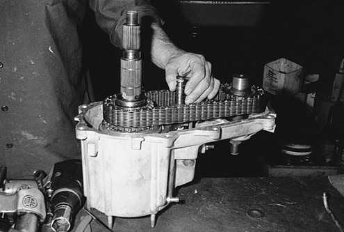 With the new heavy-duty planetary chain, sprockets, and shaft in place, the shift-shaft spring is installed and the case halves are bolted together. The heavy-duty shaft doesn&#8217t neck down at the output splines like the stock or resplined ones do. This also means a different speedometer drive gear is needed, a speciality item not to be overlooked.
