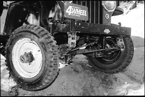 To achieve the desired ground clearance, Bill lifted the Willys 2 inches using custom springs from Midwest Spring in Denver along with Con-Ferr shackles. Greaseable bolts were made from the factory spring-pivot bolts. Monroe gas shocks were installed in the front and rear to complete the job.