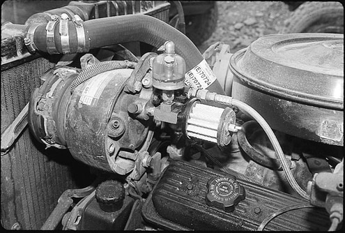 On-board air is provided by a converted air conditioning compressor. The compressor, a Harrison radial type, is relatively compact compared to other units available. Air supply for the locker is provided by the compressor, and is engaged by an Eaton-Fuller range valve located on the transfer-case lever.