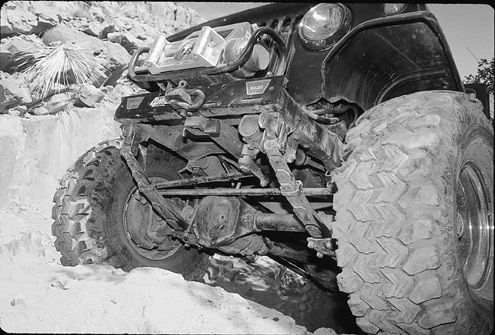 The front axle is also a 44. It houses an ARB Air Locker, Moser shafts, and 3.73 gears. Ford 1/2-ton hubs and rotors along with Chevy calipers complete the front axle. Articulation is provided by Alcan Spring 4-inch lift front and rear leaf-spring packs. The movement is controlled by Warn Black Diamond AT shocks.