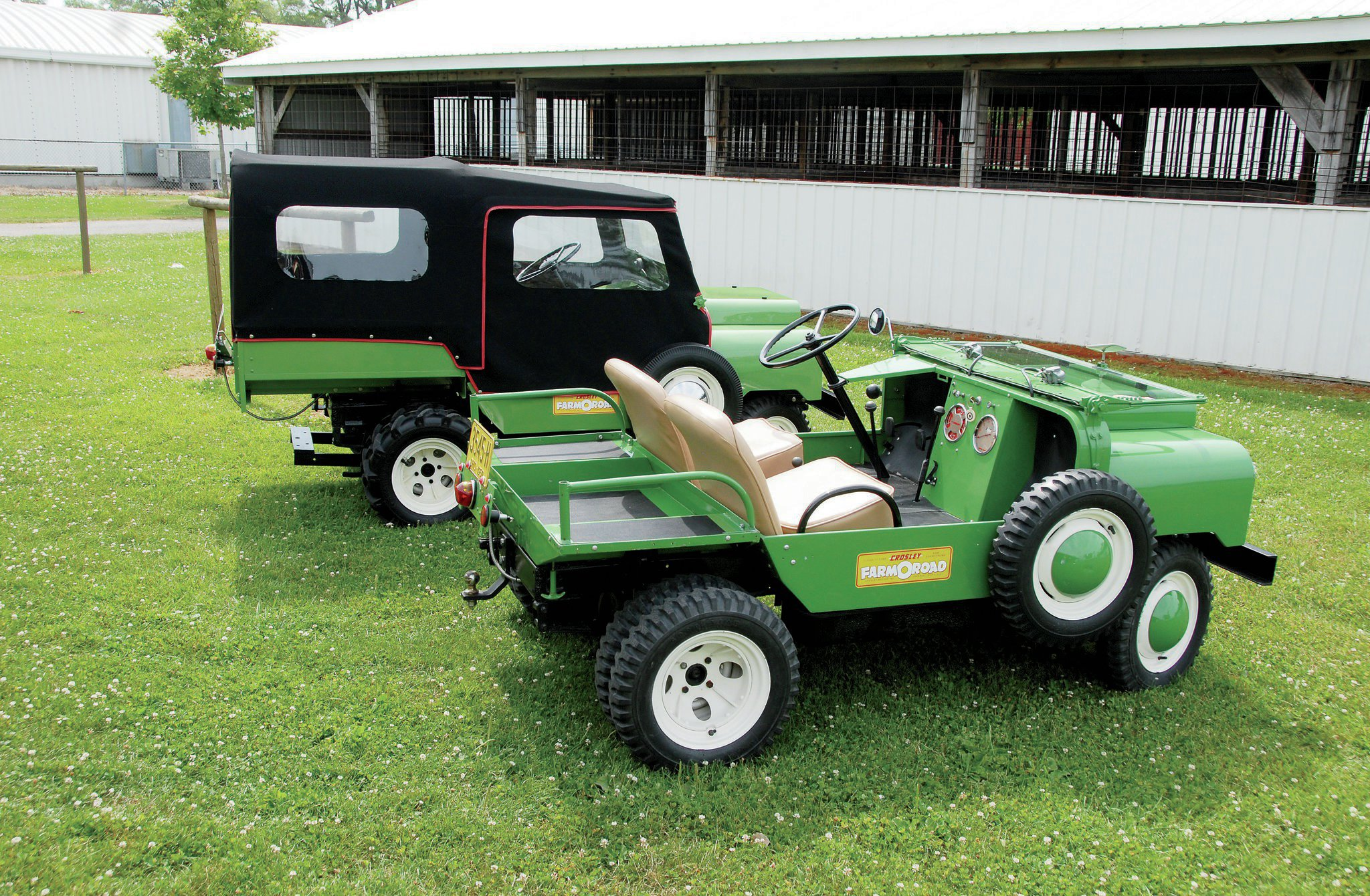 Both these are '50 models, but since Farm-O-Roads are all virtually the same, owners don't quibble about model years. From this angle, you can see the Jeep-style T-handles that hold the rear box in place on Sherman's unit. You can also see the longer dump bed and hydraulic drawbar below on Anspach's. This green is the standard and only FOR color, but they could reputably be special ordered in any color offered on Crosley cars.
