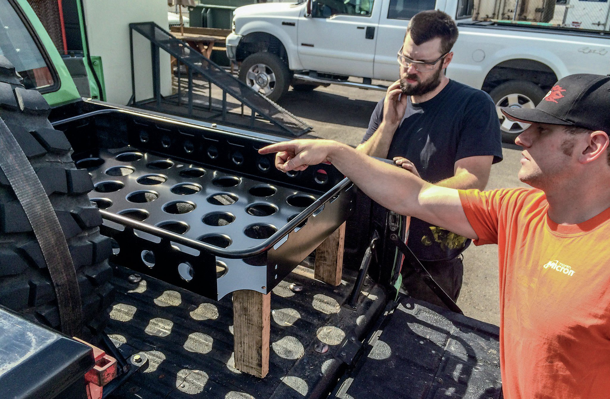 We went to Samco Fabrication and discussed our ideas with Sam Cothrun and Tim Sanders. Originally, our plan was just to have Samco cut and bend sheetmetal legs to connect the Baja Basket to the floor of our pickup.