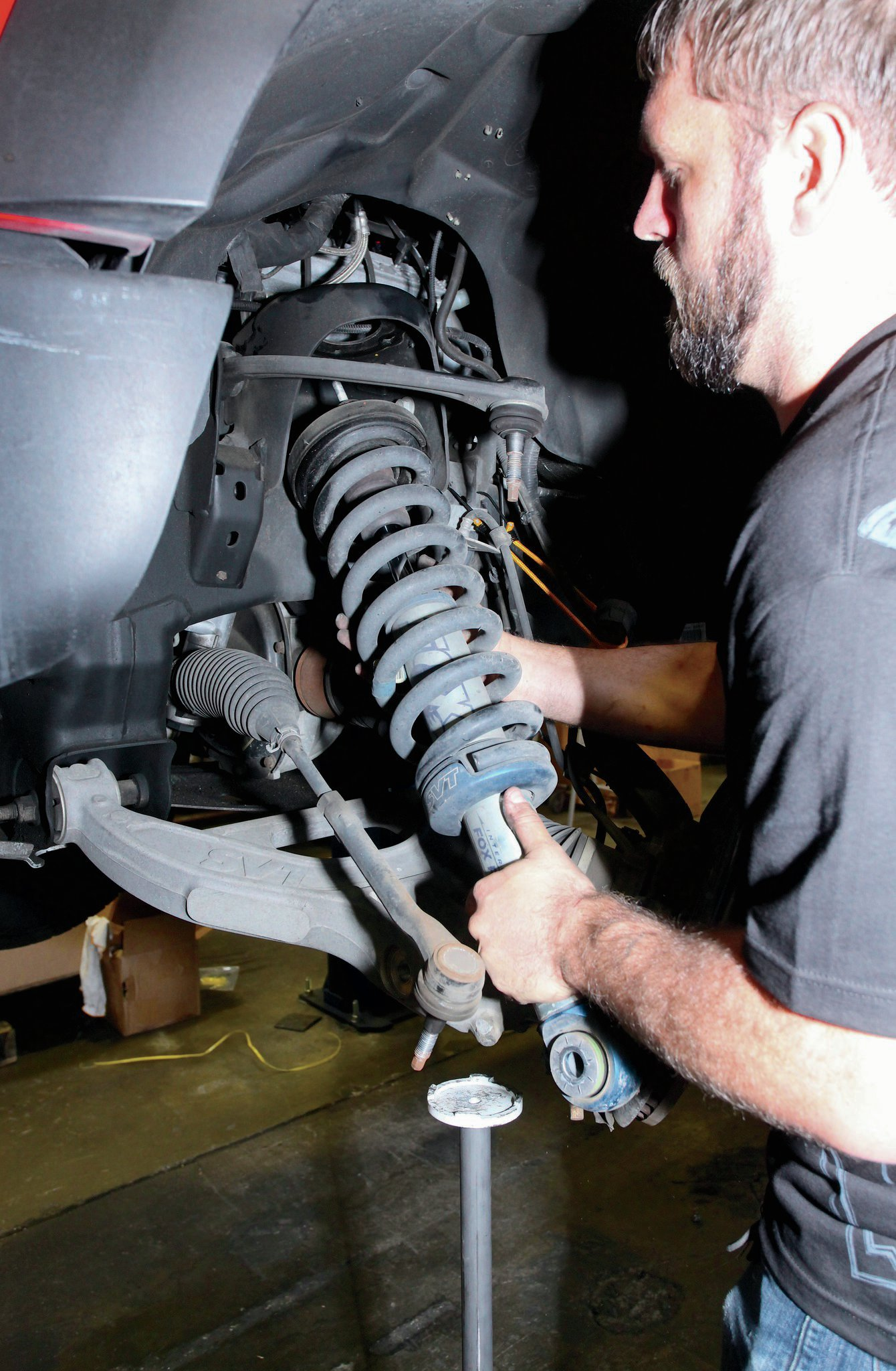 The first steps in this install is to remove the spindle and pull the shocks out.