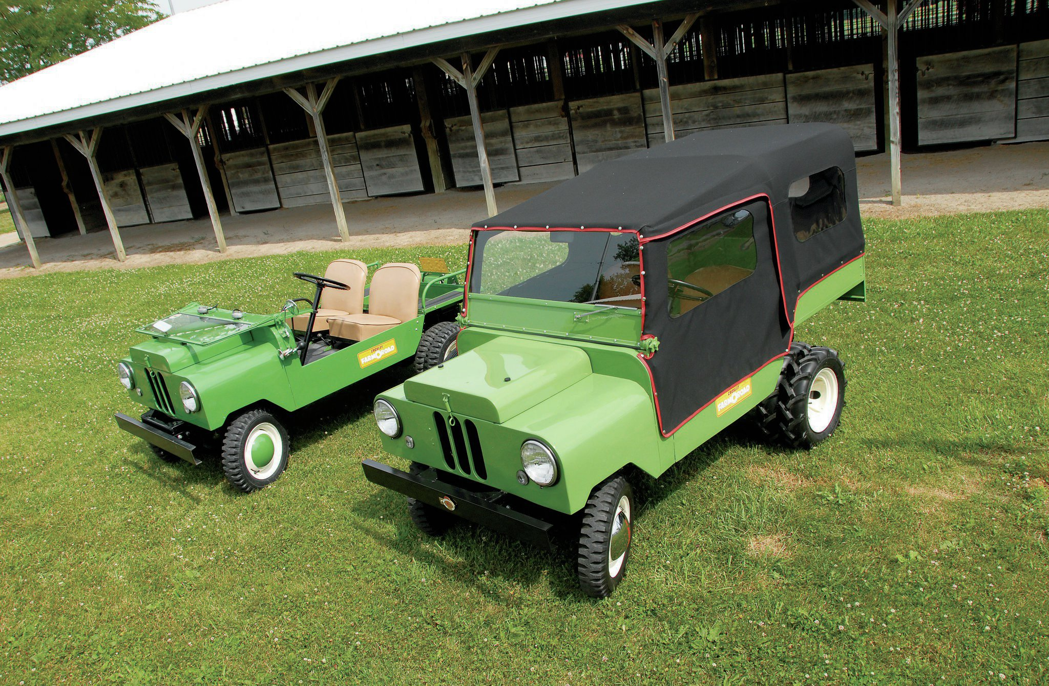 The tale of two Farm-O-Roads. Both have been restored by movers and shakers in the Farm-O-Road and Crosley community. On the left is Deane Sherman's FOR-1 with the top off. Among its options are rear duals, second windshield wiper, rear PTO, rear cargo box, and a few other small goodies. On the right is David Anspach's FOR sporting a hydraulic dump bed, rear PTO, chrome hubcaps, dual rear tractor tires, and a full top.