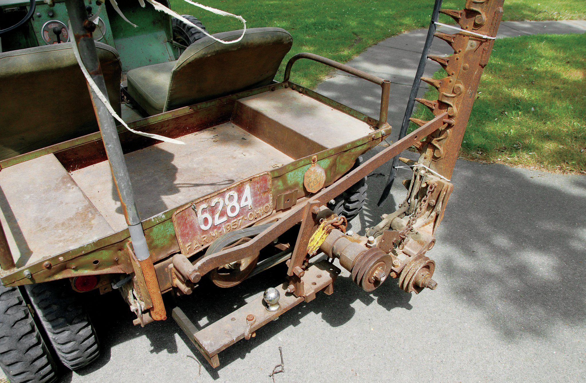 Deane Sherman's unrestored, barn-find Farm-O-Road mounts one of the more expensive accessories available from Crosley, the $175 four-foot sickle mower. It's belt driven from the rear PTO. This rig has both front and rear PTOs. fw
