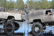 trucks gone wild south berlin mud ranch man standing between two cars