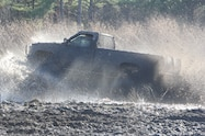 trucks gone wild south berlin mud ranch pickup truck driving though mud