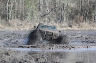 trucks gone wild south berlin mud ranch gmc truck driving though mud