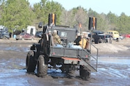 trucks gone wild south berlin mud ranch jeep truck driving though mud