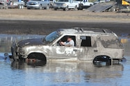 trucks gone wild south berlin mud ranch gmc jimmy driving through mud