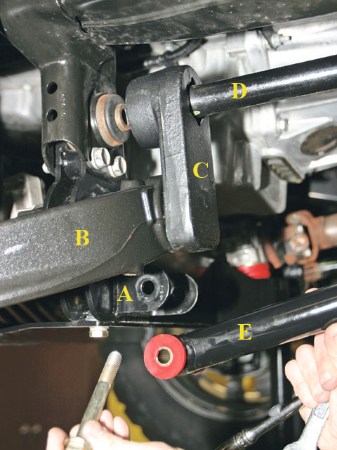 The rear of the two-piece front crossmember (A) drops and mounts the differential and the lower A arms (B). The torsion-bar relocator (C) indexes into the lower A arm and then the torsion bar (D) indexes into the relocator. Extra braces (E) run from brackets on the rear crossmember to the brackets on the front crossmember for extra support and rigidity.