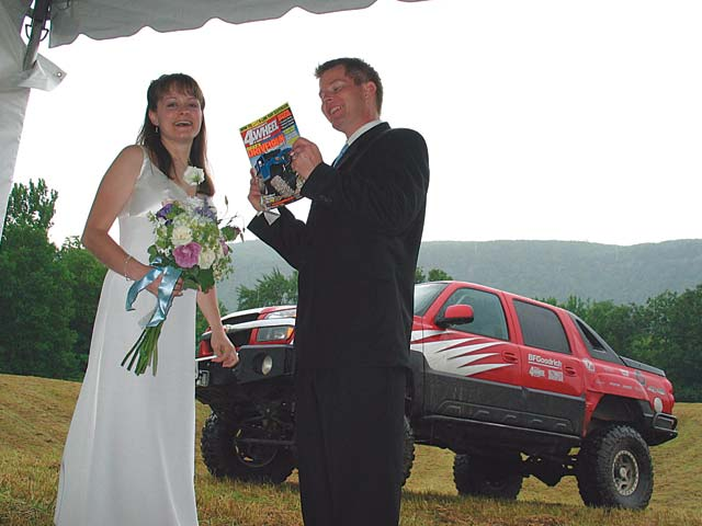 Some folks get wedding singers for entertainment, but at my brother's wedding, the new Mr. and Mrs. Williams got the '03 Ultimate Adventure Chevy Avalanche. Not bad considering rain during the ceremony made for some good mudding during the reception.
