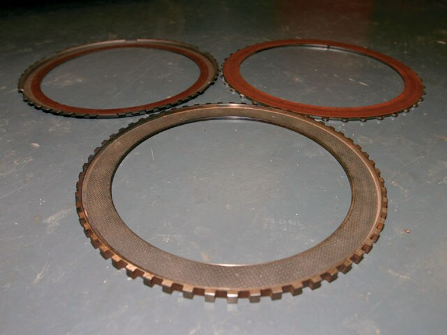 11. Here again are the three converter clutch materials. Notice the difference in color between the Wood unit and the other two. The reason for this is that the Wood clutch is made from a special high-energy material that is super-expensive and long-lasting.
