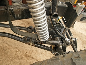 The front suspension uses a radius-arm design with the
