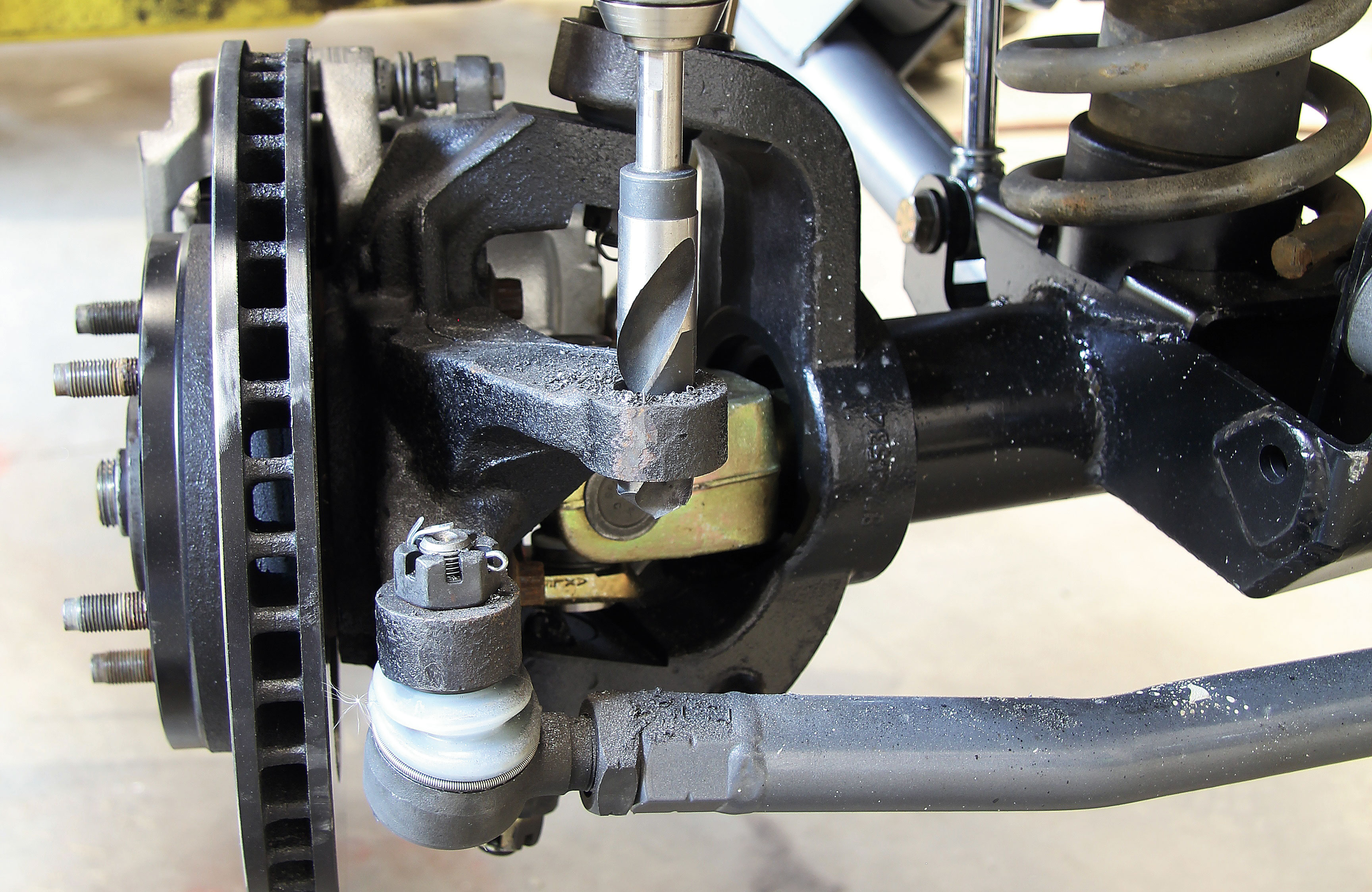 To make sure our steering geometry matched up with our track bar, we opted to run the draglink tie-rod end on top of the steering knuckle.