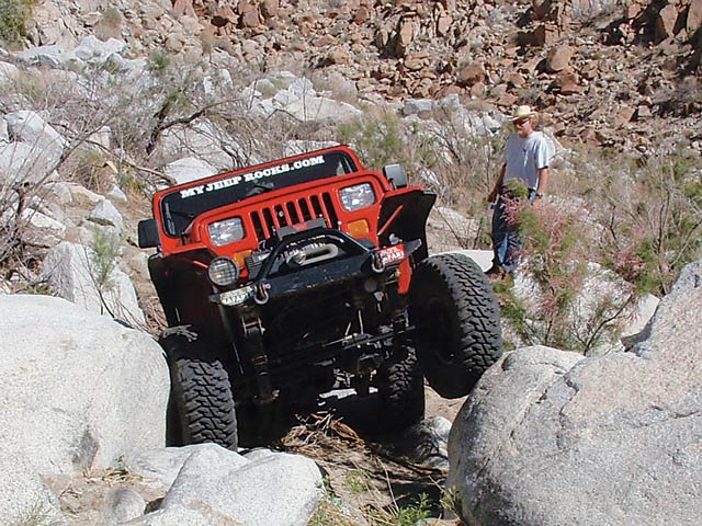 A blown Warn lockout hub wasn't enough to stop Erik Jordan and his '95 YJ. Apart from the waterfall that claimed his hub, Erik had little trouble negotiating the tough obstacles this trail has to offer. Boasting an Atlas 5:1 transfer case, Erik had the gearing to get through the day. With 4.88 cogs wrapped around dual ARBs in both the shaved 8.8 rear and CTM-equipped Dana 30, Erik motivated his 35-inch MTRs to go where he wanted them to go.