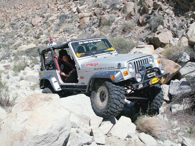 Russ Fichtelman piloted his '03 Rubicon over almost every obstacle with ease. His Rubi boasts a Kenne Bell supercharger, a Dynatrac Pro Rock 60 rear stuffed with 4.88s, and a prototype Electratrac. Russ puts the power to the ground with a set of 35-inch Krawlers wrapped around Trail Ready bead locks. However, the final waterfall did take its toll on the TJ. Russ lost two fender flares, bent a tie rod, bashed in a rear corner panel, and exploded a chromoly Dana 44 stub shaft.