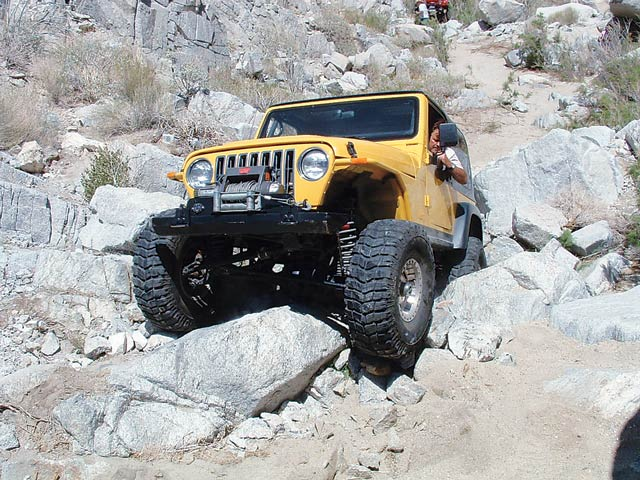 Despite the giant fender-crumpling boulders, Bryan Jensen in his '97 TJ managed to make it through the day unscathed. With power running from an Atlas 5:1 transfer case to dual ARB Air Lockers wrapped in 4.56 cogs in his Dana 30 and Dynatrac Dana 44, Bryan had his Staun bead-locked 35-inch MTRs do the grunt work.