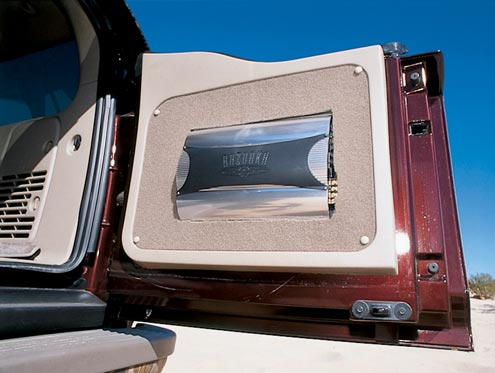 Filling the huge cabin with sound is a custom-designed Bazooka stereo system. The two amplifiers have been mounted in the rear doors so as not to use up interior space.