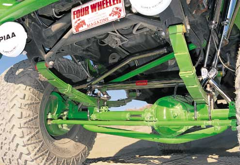 A custom-trussed Dana 44 was swapped into the front by First Engineering and uses custom mounts and 10-inch Superlift spring packs. Notice the custom crossover steering, Panhard bar, and shock mounts.