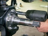 Install the small rubber seal into the back of the spindle by the