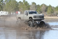 trucks gone wild south berlin mud ranch 1990 chevrolet driving though mud