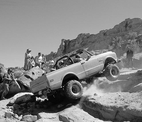 Here's an example of high gears, high power, and not much success. The stock 3.08 gears and tall tires on this Blazer require a momentum approach to the obstacle, where as lower gears and a lighter foot would help. Sometimes a blip of the throttle can ease you over a ledge, but slow and steady crawling from low gears makes it easy.