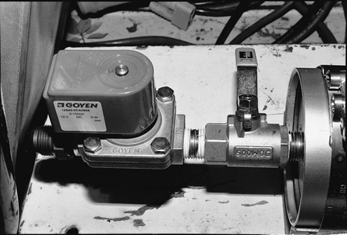 We decided to use an electric valve. It is also made by Moroso, and can be purchased from Summit. The manual valve included with the Accumulator was left in place. It can be turned off to prevent seepage if the vehicle is parked for long periods of time. All pipefittings are sealed with Teflon tape.
