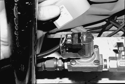 Two wires are connected to the electric valve. One of the wires is a ground and the other is connected to the included switch, mounted in the dash.