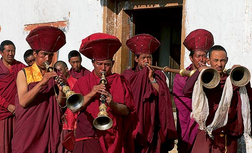 Buddhist monks at a ceremony in Karzok give us quite a welcome with an array of musical instruments.