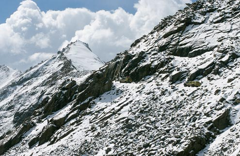 The road to Khardung La at 18,380 feet is not for the faint-hearted. With no guardrails along the pass, there are many places in which to disappear over the edge.