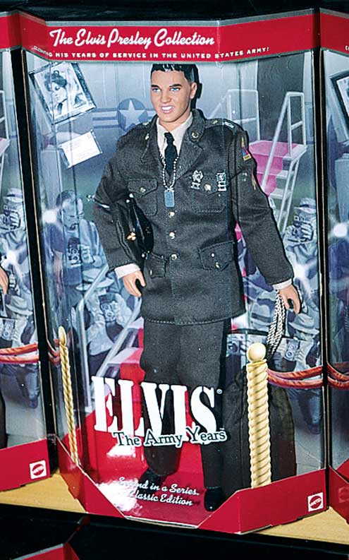 Busted for a lousy picture of an Elvis joins-the-army doll.